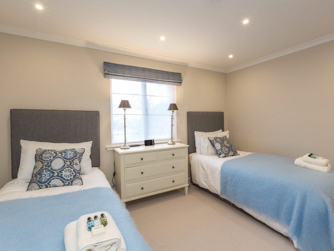 Bedroom 3 with en suite, blue blanket, two single beds